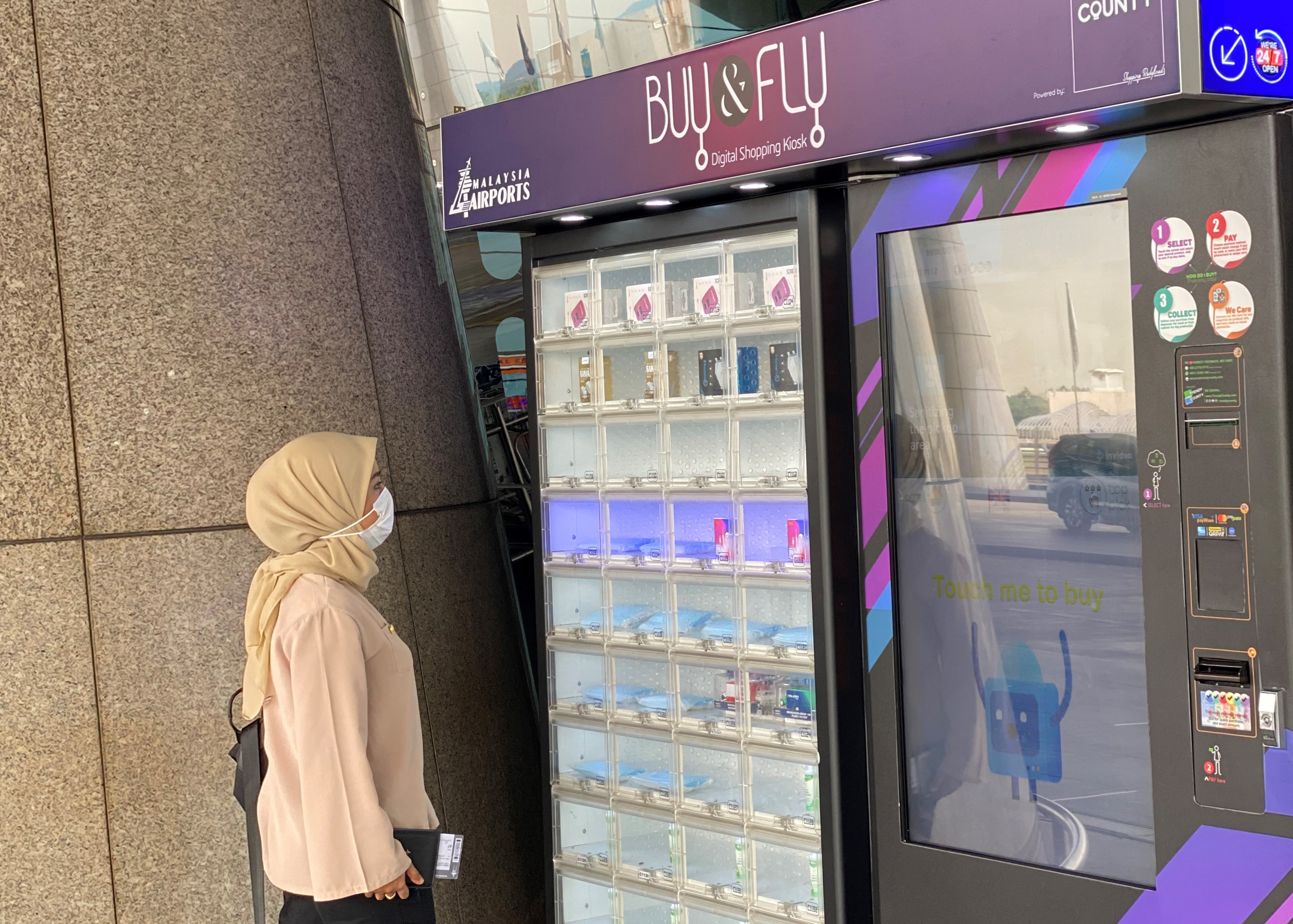 Face masks and hand sanitisers are available at the vending machine located at the entrance of KL International Airport.