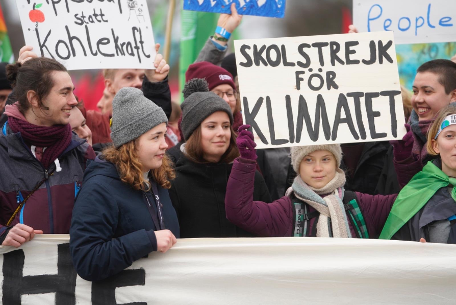"Greta during school strike week 79 in Hamburg, holding a sign "" School strike for climate"". (Photo : FB @gretathunbergsweden)"