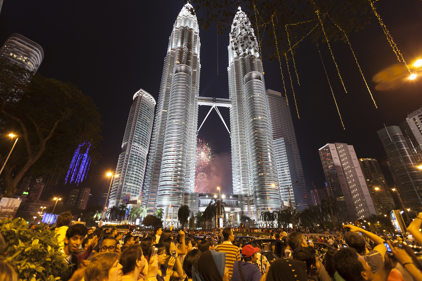 Crowd awaits fireworks at Petronas Twin Towers in KL during New Year celebrations